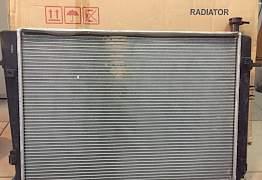 Радиатор Hyundai, KIA 253102E100 - Фото #1
